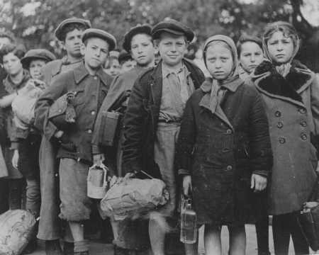 <p>Polish Jewish children, part of Brihah—the flight from Europe—en route to the Allied occupation zones in Germany and Austria. The children wait at a relief station in Prague. Czechoslovakia, 1946.</p>
