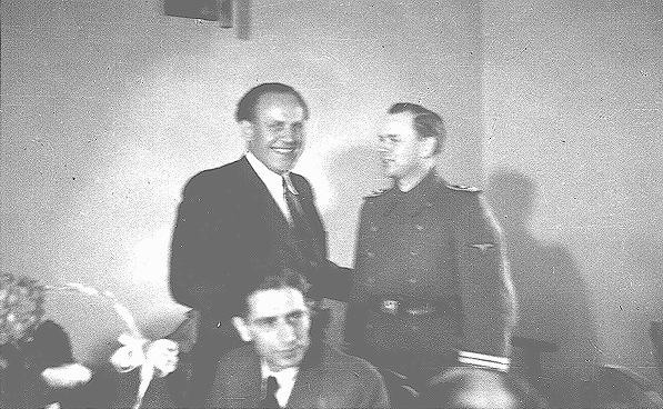 <p>Oskar Schindler (center) at his 34th birthday party with local SS officials. Schindler attempted to use his connections with German officials to obtain information that might protect his Jewish employees. Krakow, Poland, April 28, 1942.</p>