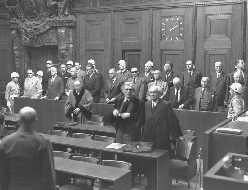 "<p>The defendants rise as the judges enter the courtroom at the <a href=""/narrative/9366"">International Military Tribunal</a> trial of war criminals at Nuremberg.</p>"