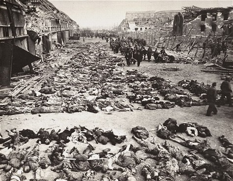 German civilians remove the bodies of prisoners killed in the Nordhausen concentration camp and lay them out in long rows outside ... [LCID: 15614]