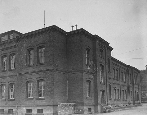 Exterior view of the Hadamar main building. The photograph was taken by an American military photographer soon after the liberation. [LCID: 05461]