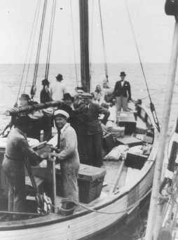 "<p>Danish fishermen (foreground) ferry Jews across a narrow sound to safety in neutral Sweden during the German occupation of <a href=""/narrative/4236/en"">Denmark</a>. Sweden, 1943.</p>"