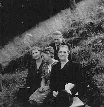 <p>Dr. Joseph Jaksy poses with (from left to right) Valeria Suran, Lydia Suran, and his wife. The Suran sisters were among 25 Jews Dr. Jaksy rescued during the war. Czechoslovakia, date uncertain.</p>