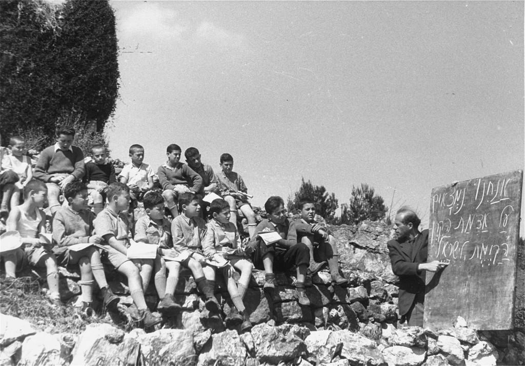 "<p>Some of the ""<a href=""/narrative/11006/en"">Tehran Children</a>,"" Polish Jewish refugees, study Hebrew in a Jewish National Fund youth village near Jerusalem. Palestine, March 9, 1943.</p>"
