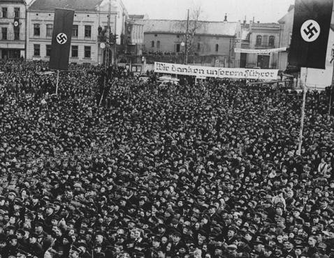 Following Germany's annexation of Memel from Lithuania, a crowd of Germans in Memel's marketplace listens to Hitler speak. [LCID: 20350]