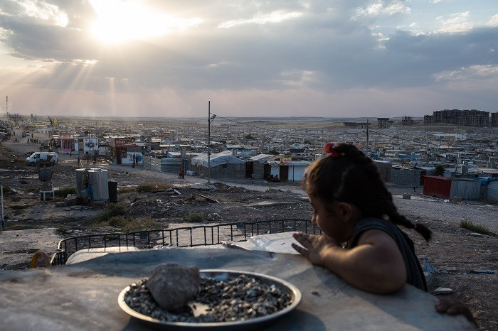 <p>A Syrian girl looks over the Domiz refugee camp outside Duhok, Iraqi Kurdistan. Sepember 5, 2015.</p>