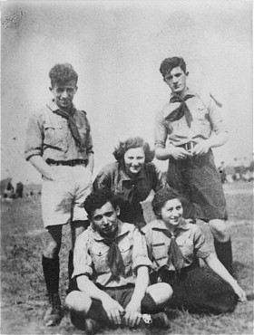 "<p>Group portrait of members of the Hashomer Hatzair socialist Zionist <a href=""/narrative/10515"">youth movement</a>. Pictured in the back row, left to right, are: Tzvi Braun, Shifra Sokolka and Mordechai Anielewicz. Seated in front are Moshe Domb and Rachel Zilberberg (""Sarenka""). Warsaw, Poland, 1938.</p>"