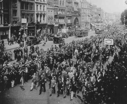 Thousands of Jews march through London's Whitechapel district to protest the persecution of Jews in Germany.