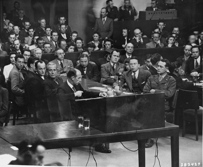 <p>The prosecution team on the day the court announced its findings at the Milch Trial. Seated at the right is US Brigadier General Telford Taylor, chief of counsel. Across from him sits Clark Denny, chief trial counsel. April 16, 1947.</p>