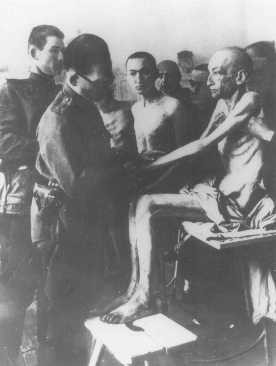 <p>Soon after liberation, a Soviet physician examines Auschwitz camp survivors. Poland, February 18, 1945.</p>