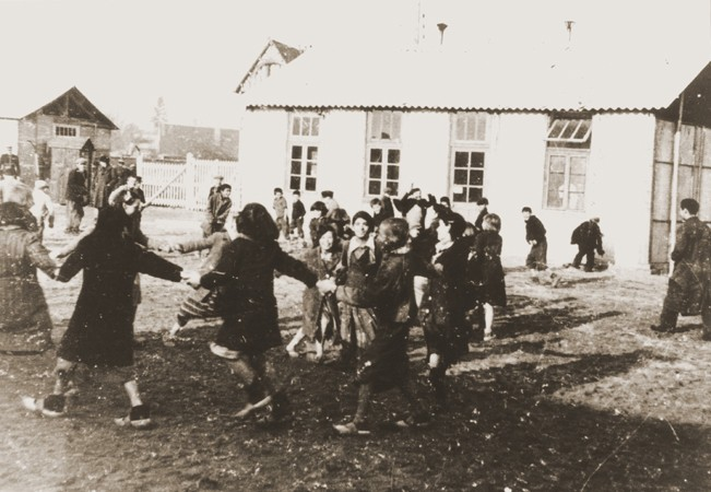 <p>Romani (Gypsy) children play outside at the Jargeau internment camp. The camp was established in response to a German order in October 1940 calling for the arrest and confinement in camps of all Frenchmen or foreigners in the Loiret region who did not have a permanent residence. Jargeau, France, 1941–45.</p> <p>Conditions in the camp were extremely poor and the lack of sanitation facilities led to the periodic outbreak of epidemics.</p>