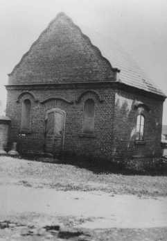 Postwar photograph of a building in Dabie where the possessions of Jews killed at the nearby Chelmno camp were stored. [LCID: 51702]