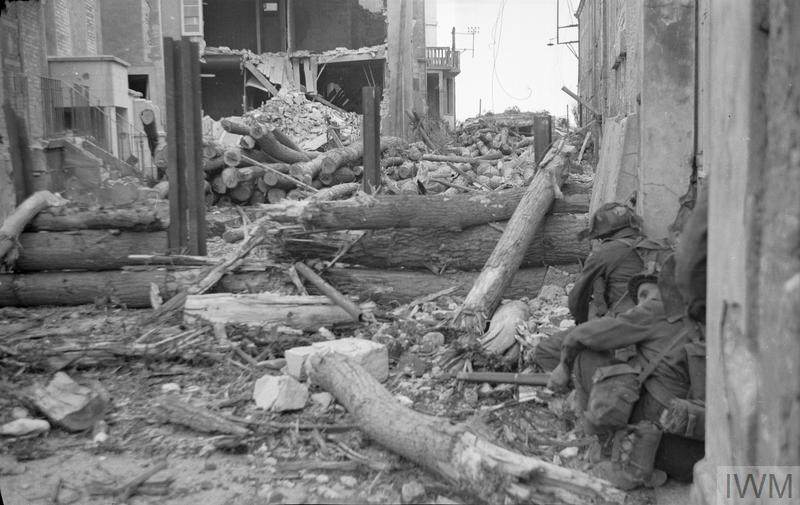 "<p>Canadian troops of the 'B' Company, North Shore (New Brunswick) Regiment take cover on June 6, 1944, or <a href=""/narrative/2899"">D-Day</a>.</p>"