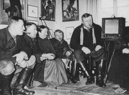 Germans listen to an antisemitic speech by Hitler. [LCID: 72139a]