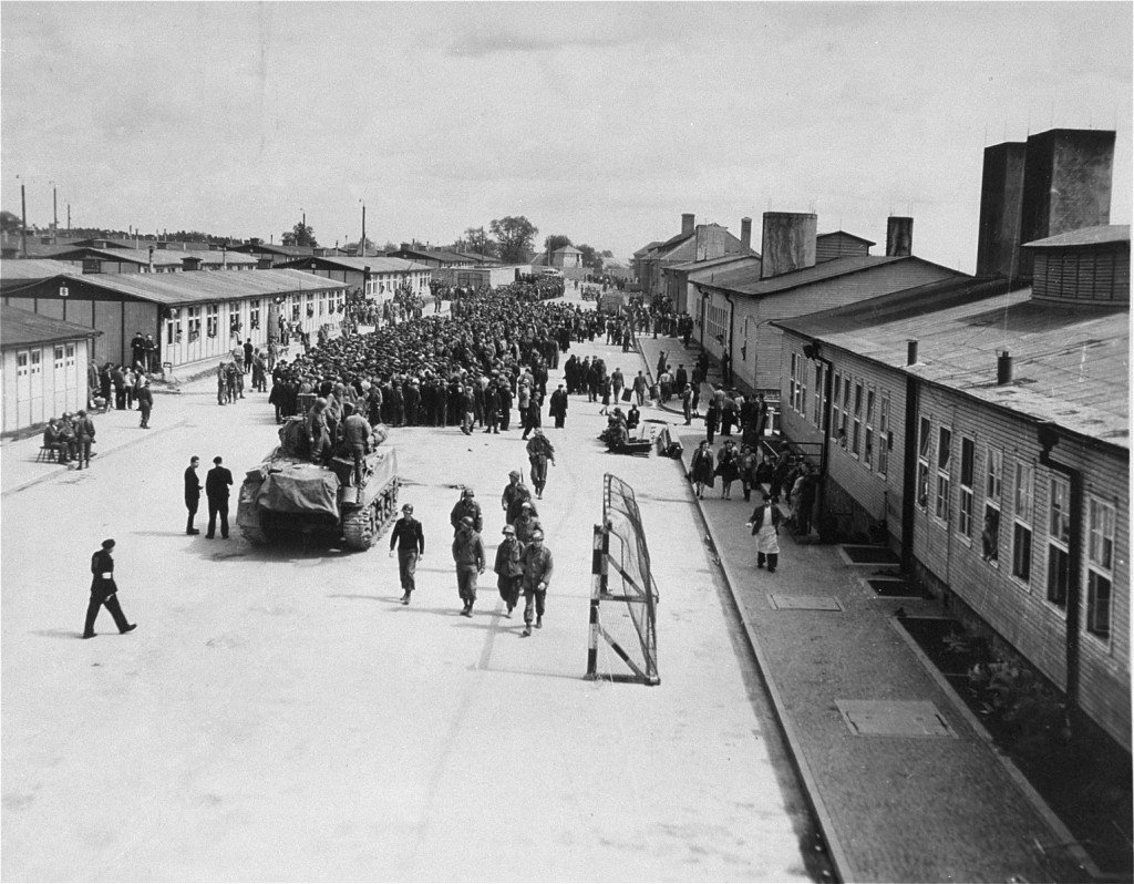 """<p><a href=""""/narrative/3880"""">Mauthausen</a> concentration camp inmates with American troops after the liberation of the camp. Mauthausen, Austria, May 5–30, 1945.</p>"""