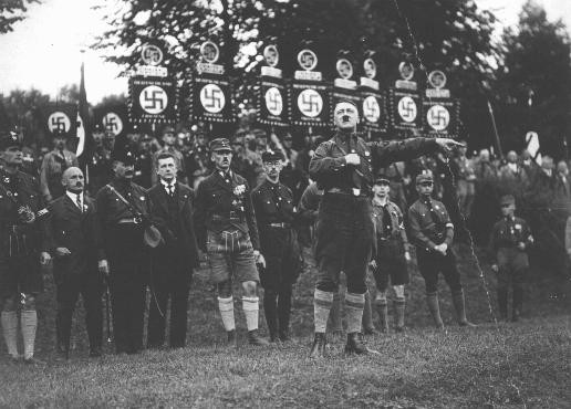 <p>Adolf Hitler speaks at a Nazi party rally. At the time, the Nazi party was a small splinter party with little influence in the Reichstag (German parliament). Nuremberg, Germany, August-September 1927.</p>