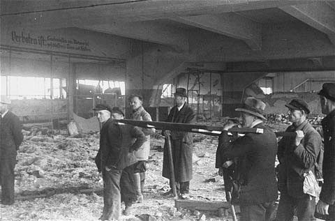 Under orders of the US First Army, German civilians prepare to use a stretcher to remove corpses of victims of the Dora-Mittelbau ... [LCID: 04534]