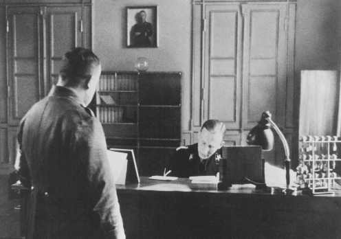 SS General Reinhard Heydrich in his office during his tenure as Bavarian police chief. [LCID: 82550]