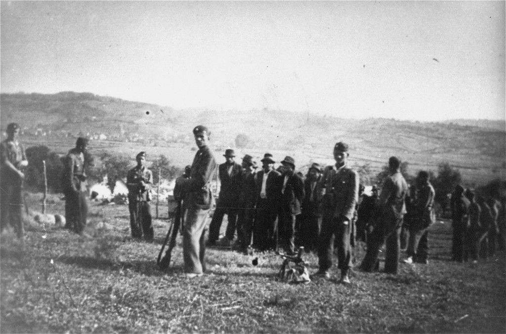 <p>Ustaša (Croatian fascist) soldiers oversee the deportation of a group of civilians from Kozara region to a concentration camp, in the pro-German fascist state of Croatia established following the partition of Yugoslavia. Croatia, between 1941 and 1944.</p>