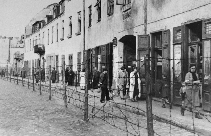 View of a barbed-wire fence separating part of the ghetto in Krakow from the rest of the city. [LCID: 73173]