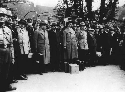 "<p>Under SA guard, a group of leading Socialists arrives at the Kislau camp, one of the <a href=""/narrative/4656"">early concentration camps</a>. Local Social Democratic party leader Ludwig Marum is fourth from the left in the line of arrivals. Kislau, Germany, May 16, 1933.</p>"