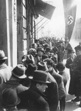 <p>Jews wait in front of the Polish Embassy for entrance visas to Poland after Germany's annexation of Austria. Vienna, March or April 1938.</p>