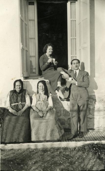 <p>Reine (seated in window) and Yishua Ghozlan (standing) were married in Constantine, Algeria, on March 29, 1932. They are pictured here with two of their parents. </p>