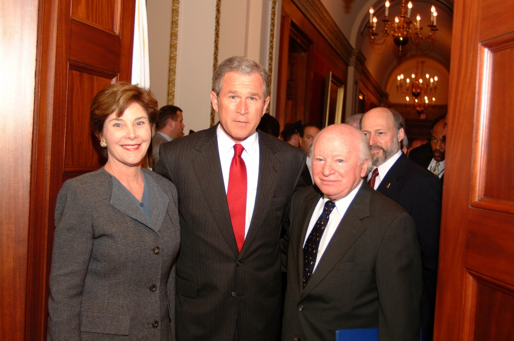 """<p>Laura Bush, George Bush, and Benjamin Meed during the Days of Remembrance ceremony in 2001, the theme of which was """"Remembering the past for the sake of the future.""""Days of Remembrance was established by the United States Congress as the United States' annual commemoration of the victims of the Holocaust, just as the United States Holocaust Memorial Museum was established as a permanent living memorial to those victims.</p>"""