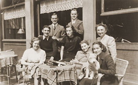 The Jacobsthal family poses at an outdoor cafe. Amsterdam, the Netherlands, late 1930s.