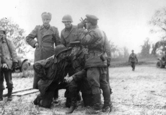 <p>An African American soldier is among those members of the Soviet and US armed forces posing here upon the historic meeting of the two armies on the Elbe River. Torgau, Germany, April 26, 1945.</p>