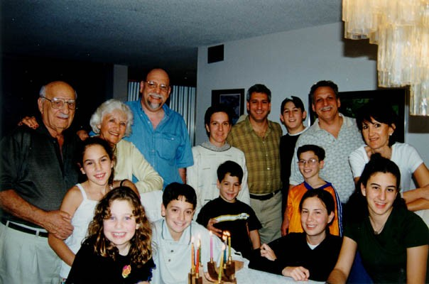 The extended Derman family.  Top row, left to right: Aron, Lisa, Howard, Miriam, Daniel, Ari, Gordon, and Barbara (Howie's wife). [LCID: derm17]