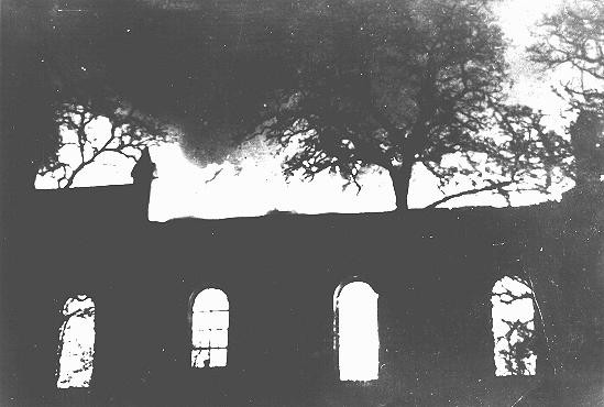 "A synagogue burns during Kristallnacht (the ""Night of Broken Glass"")."