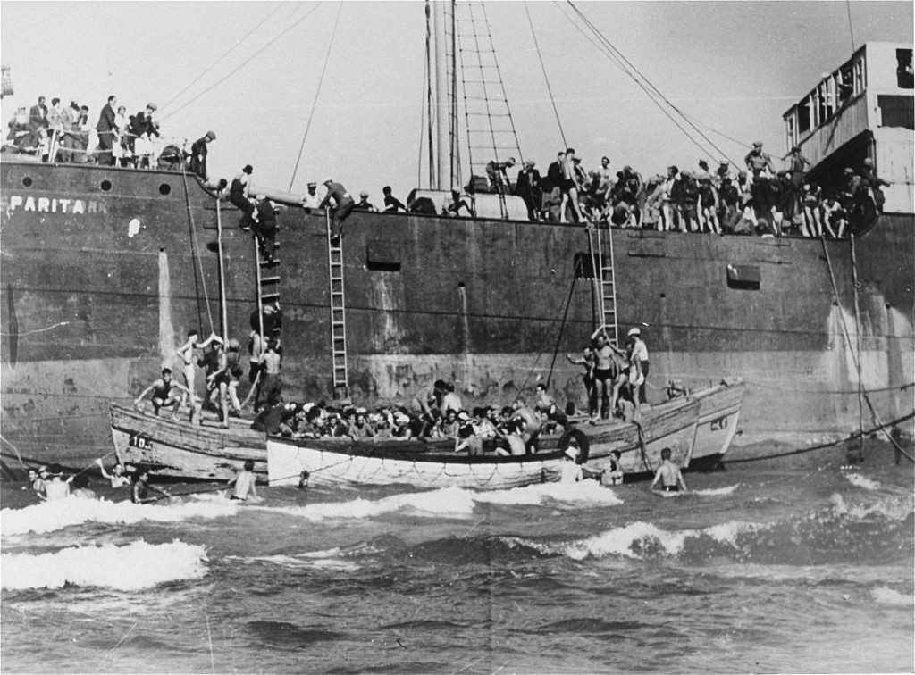 "<p>The <a href=""/narrative/7475"">Aliyah Bet</a> (""illegal"" immigration) ship <em>Parita</em>, carrying 850 Jewish refugees, lands on a sandbank off the Tel Aviv coast. The British arrested the passengers and interned them at Atlit detention camp. Palestine, August 21, 1939.</p>"