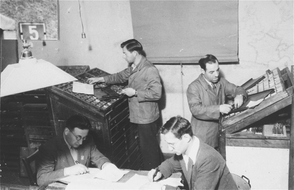 <p>Jewish refugees work on a newspaper at Zeilsheim displaced persons camp. Germany, between 1945 and 1948. The newspaper was titled <em>Unterwegs</em> (The Transient). </p>