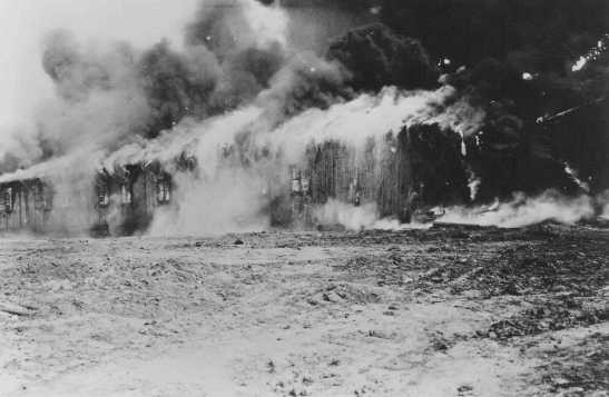 The Bergen-Belsen former concentration camp is burned to the ground to halt the spread of typhus. [LCID: 75136]