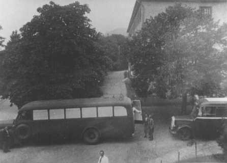 "<p>Buses used to transport patients from the Eichberg hospital near Wiesbaden to <a href=""/narrative/8116"">Hadamar</a> euthanasia center. The windows were painted to prevent people from seeing those inside. Germany, between May and September 1941.</p>"