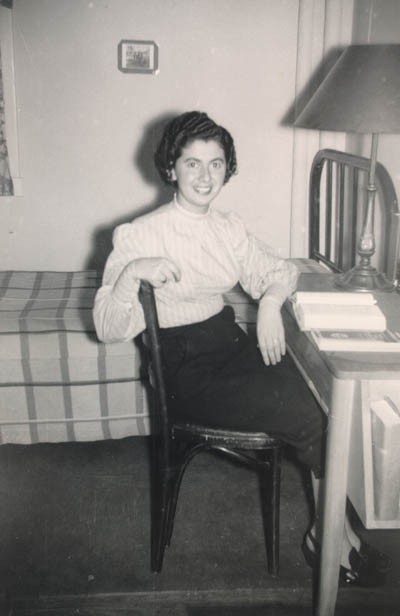Regina in her college dormitory room at Indiana University. [LCID: gelb26]