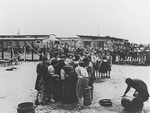 After liberation by US troops, former prisoners wait in line for soup. [LCID: 45035a]