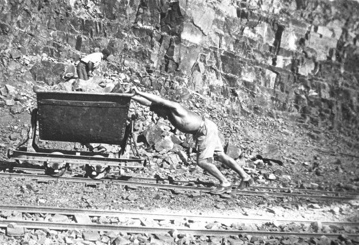 <p>A German Jewish prisoner named Rosenthal pushes a cart in the stone quarry of the Im Fout labor camp in Morocco. The camp housed a group of foreign workers, many of whom fell ill because of poor living conditions. Im Fout, Morocco, 1941-42.</p>