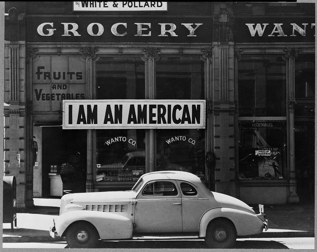 Tatsuro Matsuda, whose family owned the Wanto Co. grocery store, hung this sign in front of the store, Oakland, California, March 1942. The store was closed following orders for the evacuation of American residents of Japanese ancestry. Evacuees were forcibly deported to relocation centers.