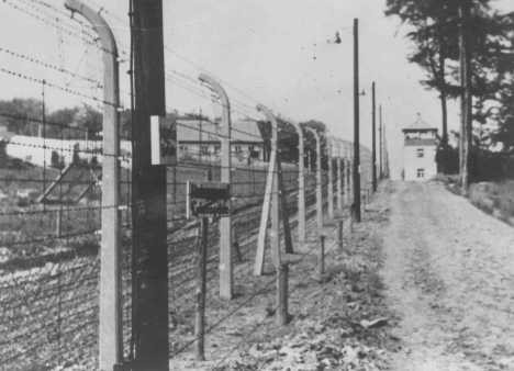 View of a guard tower and fence at the Buchenwald concentration camp. [LCID: 80136]