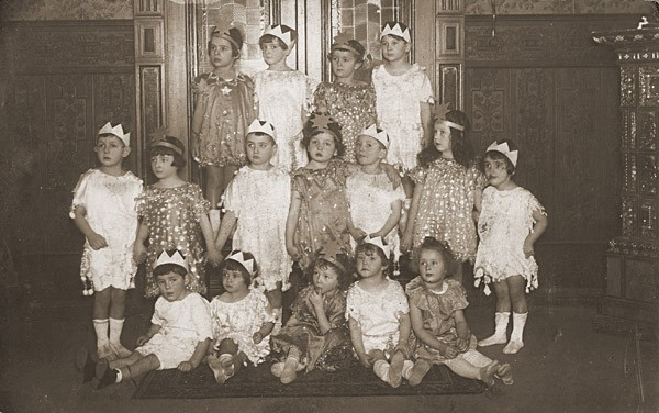 Group portrait of children dressed in Purim costumes. [LCID: 28392]