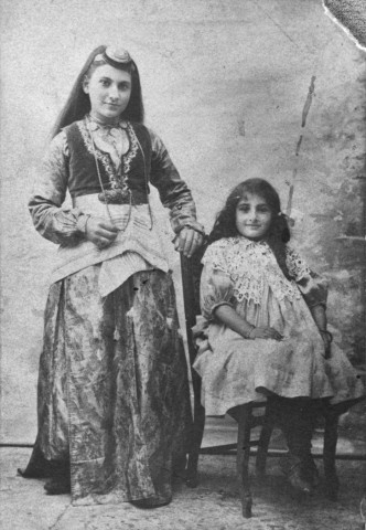 <p>Studio portrait of two Armenian girls wearing traditional clothing. Ottoman Empire, ca 1895. [Courtesy of Mabel Aharonian]</p>