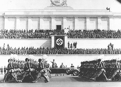<p>Reich Labor Service battalions parade before Hitler during the Nazi Party Congress. Nuremberg, Germany, September 8, 1937.</p>