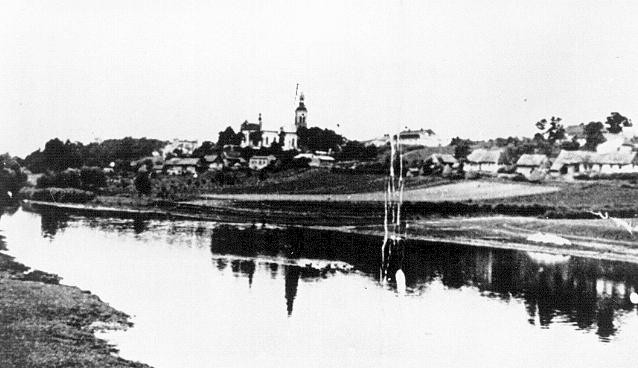 View of the village of Chelmno. To the left of the church is the Schloss, one of two sites of the Chelmno camp. [LCID: 74883]