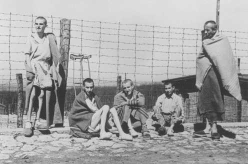 Emaciated survivors of the Buchenwald concentration camp soon after the liberation of the camp. [LCID: 78656]