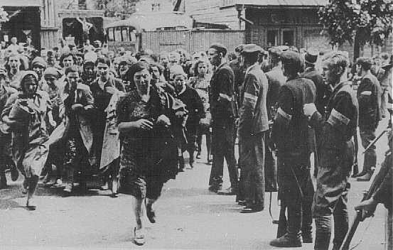 <p>Lithuanian militiamen in Kovno round up Jewish women. Kovno, Lithuania, June-July, 1941.</p>