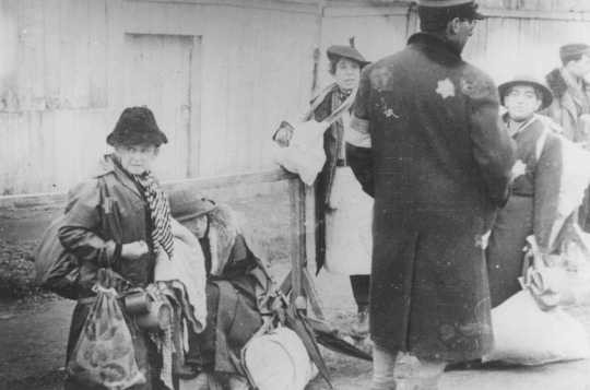 "<p>Jewish deportees from Luxembourg, Austria, and Czechoslovakia during deportation from the <a href=""/narrative/2152/en"">Lodz</a> ghetto to the <a href=""/narrative/3852/en"">Chelmno</a> killing center. Lodz, Poland, 1942.</p>"