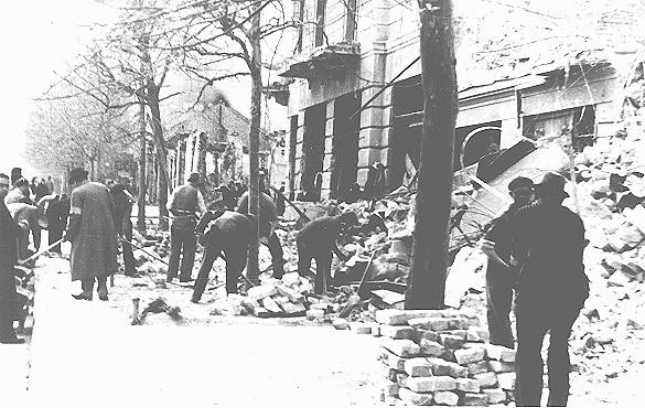 <p>Jews forced to clear rubble from streets following the bombardment of Belgrade. Belgrade, Yugoslavia, 1941.</p>