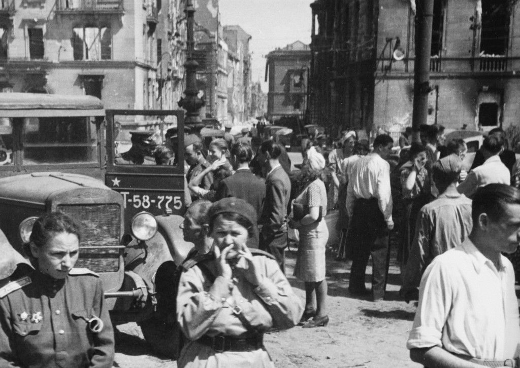 Soviet soldiers in a street in the Soviet occupation zone of Berlin following the defeat of Germany.